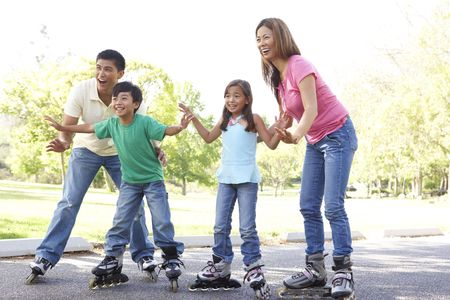 Family Putting On In Line Skates In Park Stock Photo - 6456455