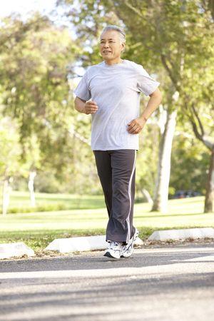 asian senior: Senior Man Jogging In Park