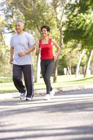 Senior Couple Jogging In Park Stock Photo - 6456099