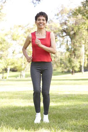 Senior Woman Jogging In Park photo