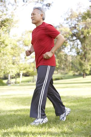 Senior Man Jogging In Park photo