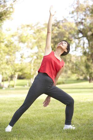 Senior Woman Exercising In Park Stock Photo - 6456580