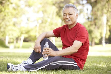 Senior Man Relaxing After Exercise photo