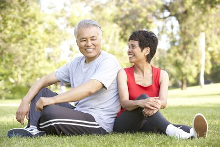 Senior Couple Resting After Exercise photo