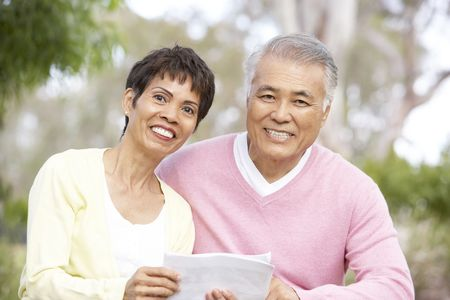 older women: Portrait Of Senior Couple Looking At Map Stock Photo