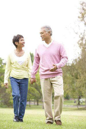 Senior Couple Walking In Park Stock Photo - 6456230