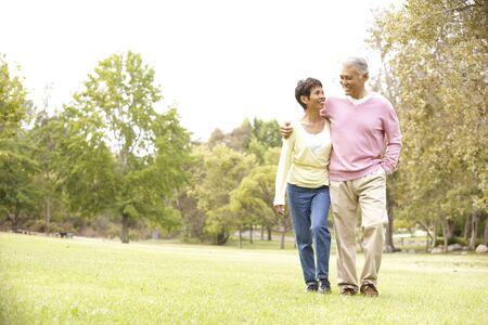 Senior Couple Walking In Park Stock Photo - 6456298