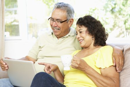 Senior Couple Using Laptop At Home photo