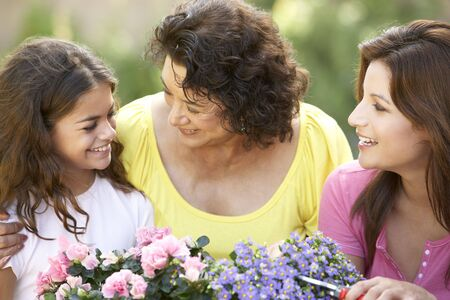 Senior Woman With Adult Daughter And Granddaughter Gardening Together Stock Photo - 6456554