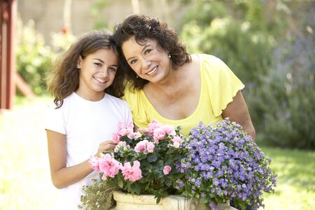 Grandmother And Granddaughter Gardening Together Stock Photo - 6456505