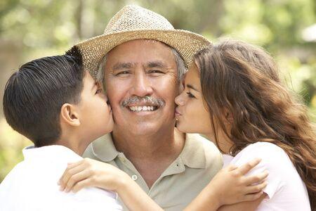 Grandfather With Grandchildren In Garden Stock Photo - 6456507