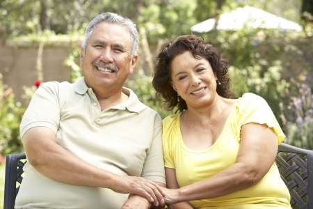 retired: Senior Couple Relaxing In Garden Together Stock Photo
