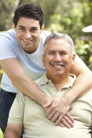 Senior Man With Adult Son In Garden Stock Photo - 6456371