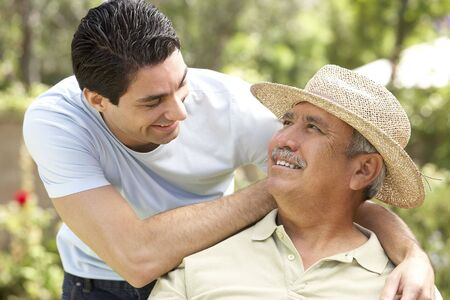 Senior Man With Adult Son In Garden Stock Photo - 6456407