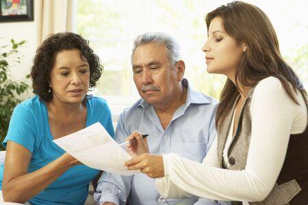 Senior Couple With Financial Advisor At Home Stock Photo - 6456536