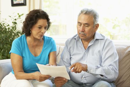 bejaardenhuis: Senior Couple Studying Financial Document At Home