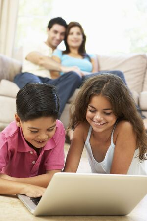 Children Using Laptop At Home photo