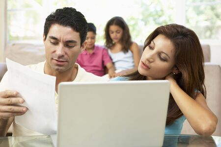 Parents Using Laptop At Home photo