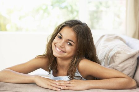 7 year old girl: Family Playing Game Together At Home Stock Photo