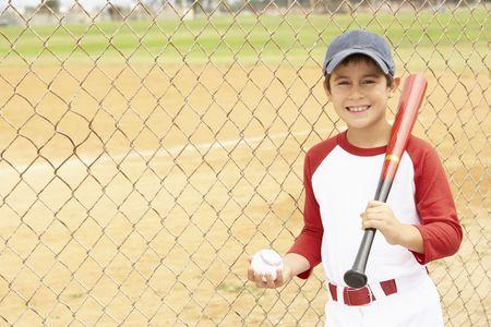 9 ball: Young Boy Playing Baseball Stock Photo