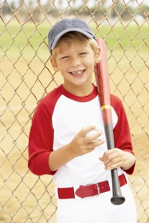 baseball caps: Young Boy Playing Baseball Stock Photo
