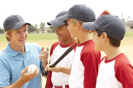 Young Boys In Baseball Team With Coach photo