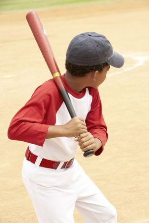bats: Young Boy Playing Baseball Stock Photo