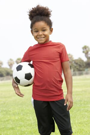 female soccer: Young Girl In Football Team Stock Photo