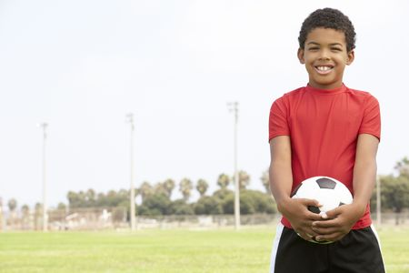 female soccer: Young Boy In Football Team Stock Photo