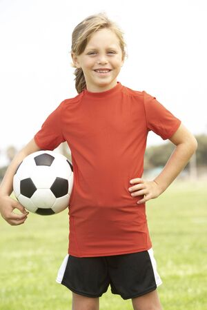 7 year old girl: Young Girl In Football Team Stock Photo