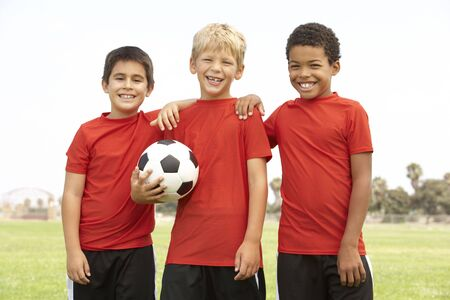 excited people: Young Boys In Football Team Celebrating Stock Photo