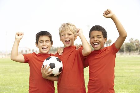 Young Girls In Football Team Celebrating Stock Photo