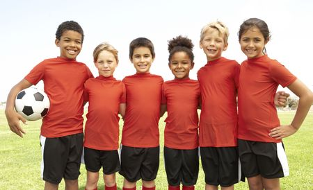 female soccer: Young Boys And Girls In Football Team