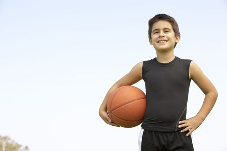 one little boy: Young Boy Playing Basketball Stock Photo