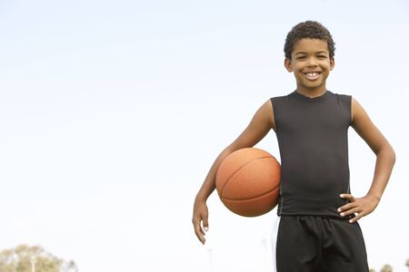 9 ball: Young Boy Playing Basketball Stock Photo