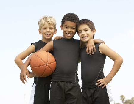 a basketball player: Young Boy Playing Basketball Stock Photo