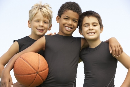 basketball team: Young Boy Playing Basketball Stock Photo