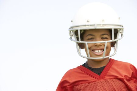 Young Boy Playing American Football photo