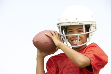 Young Boy Playing American Football Stock Photo - 6453603