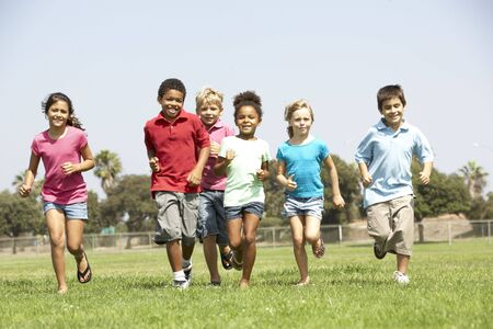 american children: Group Of Children Running In Park