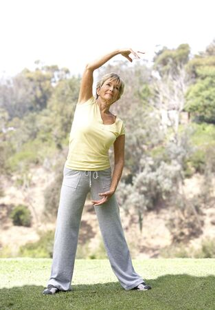 Senior Woman Exercising In Park Stock Photo - 6452471
