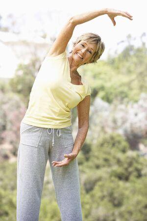 woman exercising: Senior Woman Exercising In Park