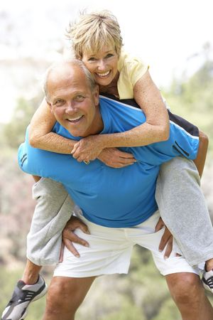 enjoy space: Senior Couple Exercising In Park Stock Photo