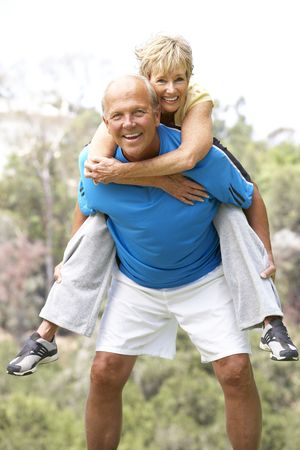 exercising: Senior Couple Exercising In Park Stock Photo