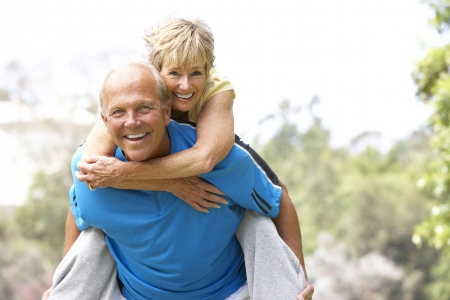 piggyback: Senior Couple Exercising In Park Stock Photo