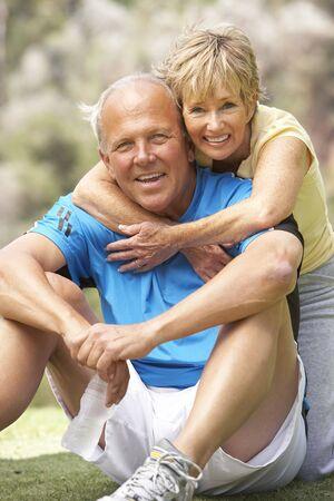 Senior Couple Exercising In Park Stock Photo - 6451865