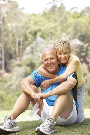Senior Couple Exercising In Park Stock Photo - 6452056
