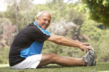 Senior Man Exercising In Park Stock Photo - 6452620