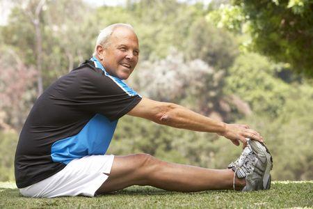 Senior Man Exercising In Park photo