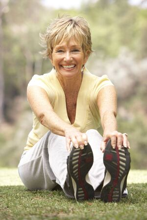 exercising: Senior Woman Exercising In Park